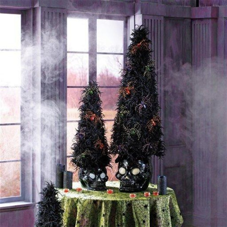 Photo - This product image released by Grandin Road shows their black flocked trees.  This season you'll find lots of ghoulish yet glamorous pieces to decorate with for Halloween.    (AP Photo/Grandin Road)