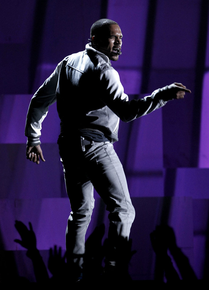 Photo - Chris Brown performs during the 54th annual Grammy Awards on Sunday, Feb. 12, 2012 in Los Angeles. (AP Photo/Matt Sayles) ORG XMIT: CASH279