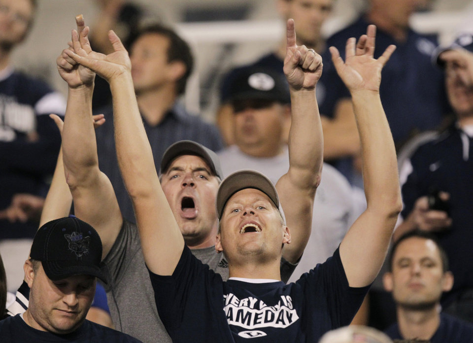 Photo -   BYU fans celebrate after a score in the second quarter of an NCAA college football game against Utah on Saturday, Sept. 15, 2012, in Salt Lake City. (AP Photo/Rick Bowmer)