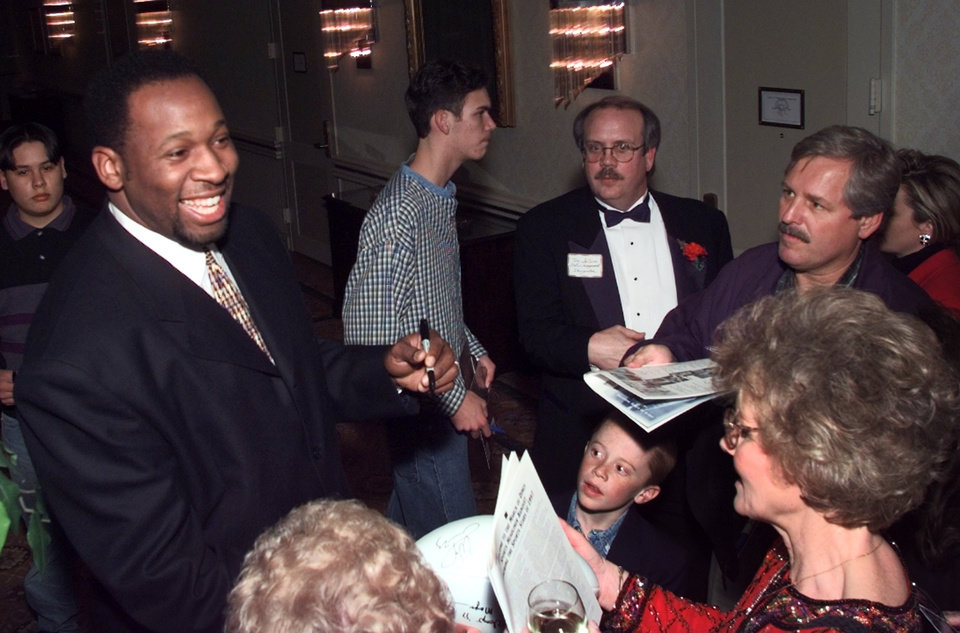 Photo - Wayman Tisdale signs autographs before the March of Dimes Sports Headliner Banquet.