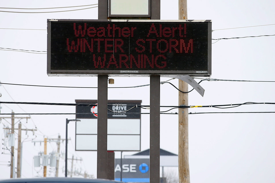 Photo - A sign outside a pharmacy during a winter storm in Oklahoma City, Sunday, Feb. 14, 2021. [Bryan Terry/The Oklahoman]