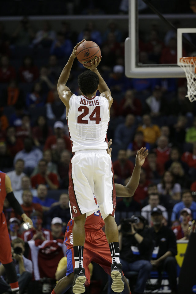 Photo - Stanford forward Josh Huestis (24) shoots against  Dayton during the first half in a regional semifinal game at the NCAA college basketball tournament, Thursday, March 27, 2014, in Memphis, Tenn. (AP Photo/Mark Humphrey)