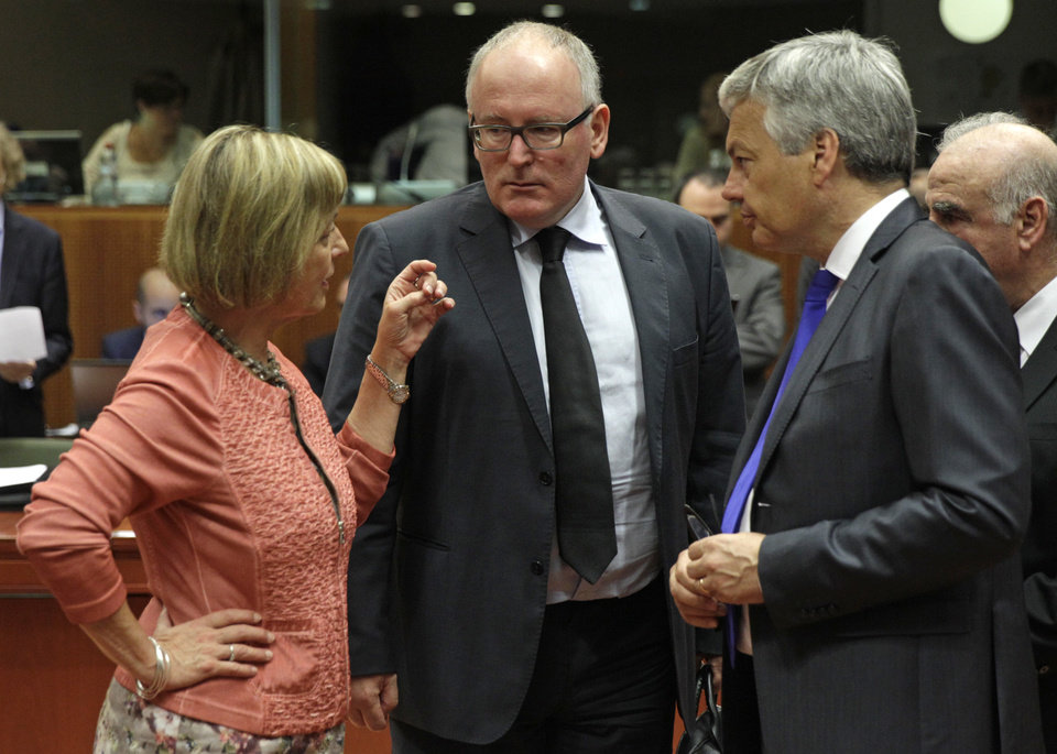 Photo - Dutch Foreign Minister Frans Timmermans, center, talks with Croatia's Foreign Minister Vesna Pusic, left, and Belgium's Foreign Minister Didier Reynders, during the EU foreign ministers council at the European Council building in Brussels, Tuesday, July 22, 2014. European Union foreign ministers are meeting to consider further sanctions against Russia because of the downing of the Malaysian jetliner, with Britain and some other countries demanding much tougher measures. (AP Photo/Yves Logghe)
