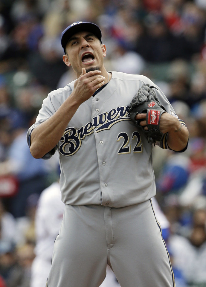 Photo - Milwaukee Brewers starter Matt Garza reacts after Chicago Cubs' Nate Schierholtz walked to first base during the first inning of a baseball game in Chicago, Saturday, May 17, 2014. (AP Photo/Nam Y. Huh)
