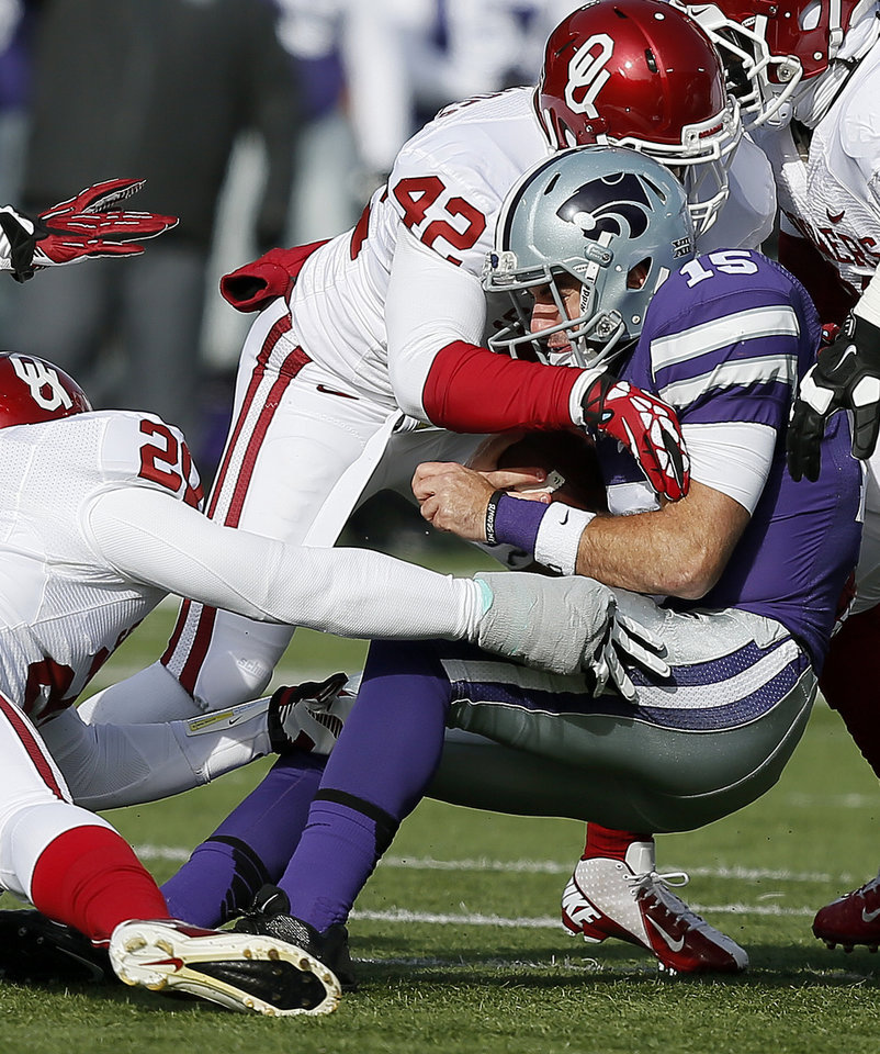 Photo - Oklahoma's Frank Shannon, left, and Dominique Alexander, center, bring down Kansas State's Jake Waters during the Sooners' 41-31 victory over the Wildcast on Nov. 23. Alexander has 75 tackles — second-most on the team — this season. Photo by Bryan Terry, The Oklahoman