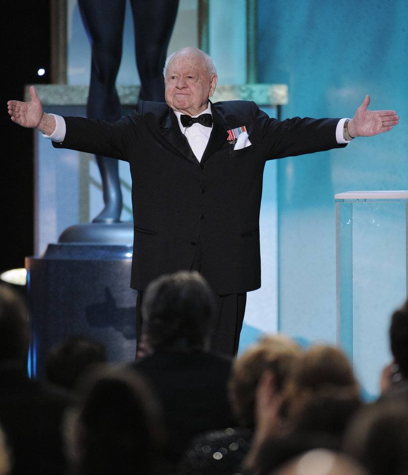Photo - FILE - In this Sunday, Jan. 27, 2008, file photo, Mickey Rooney takes the stage to make an award presentation at the 14th Annual Screen Actors Guild Awards, in Los Angeles. Rooney, a Hollywood legend whose career spanned more than 80 years, has died. He was 93. Los Angeles Police Commander Andrew Smith said that Rooney was with his family when he died Sunday, April 6, 2014, at his North Hollywood home. (AP Photo/Mark J. Terrill, File)