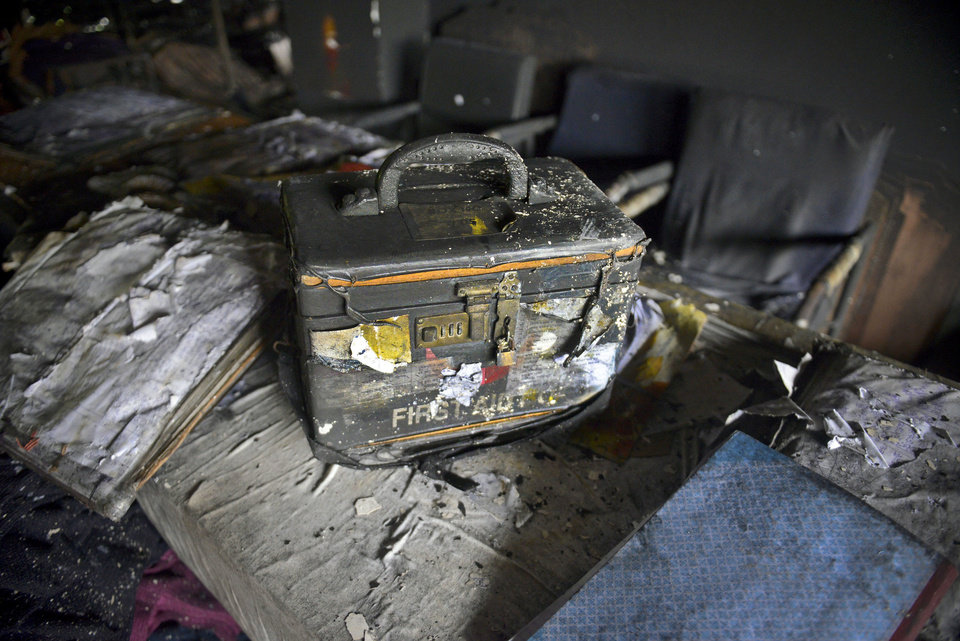 Photo - A damaged first aid kit box sits inside a garment factory that caught fire in Dhaka, Bangladesh, Thursday, May 9, 2013. A fire in the 11-story garment factory in Bangladesh killed eight people, including a ruling-party politician and a top official in the country's powerful clothing manufacturers' trade group, as the death toll from the collapse of another garment factory building passed 900 on Thursday. (AP Photo/Ismail Ferdous)