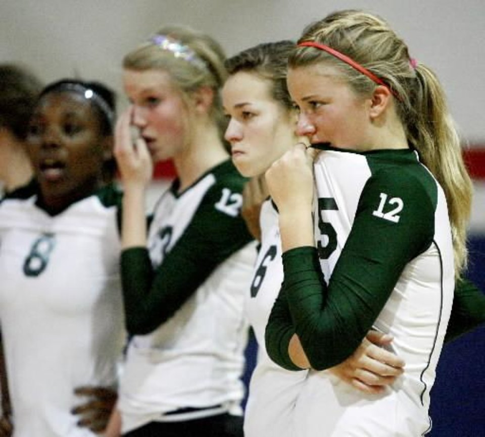 Alex Hodges, right, and Kylie Smelser of Edmond  Santa  Fe react after their loss in the Class 6A state  volleyball championship between Owasso and Edmond  Santa  Fe in Moore, Okla., Saturday, October 18. BY BRYAN TERRY