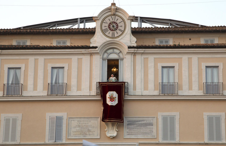 Photo - Pope Benedict XVI speaks from the balcony window of the Pontifical summer residence in Castel Gandolfo, some 35 kilometers south of Rome, to a cheering crowd gathered to see him off the day he ends his pontificate, Thursday, Feb. 28, 2013. (AP Photo/Domenico Stinellis)
