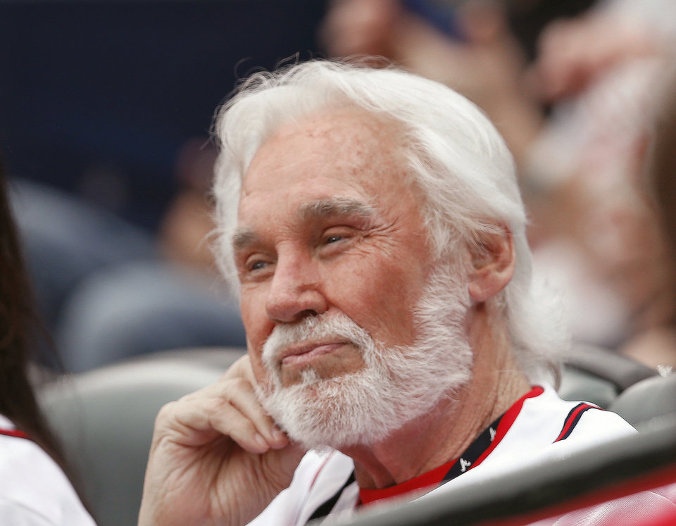 Photo - Country music recording artist Kenny Rogers looks on before the start of a of a baseball game between the Miami Marlins and Atlanta Braves  in Atlanta, Monday, July 21, 2014. (AP Photo/John Bazemore)