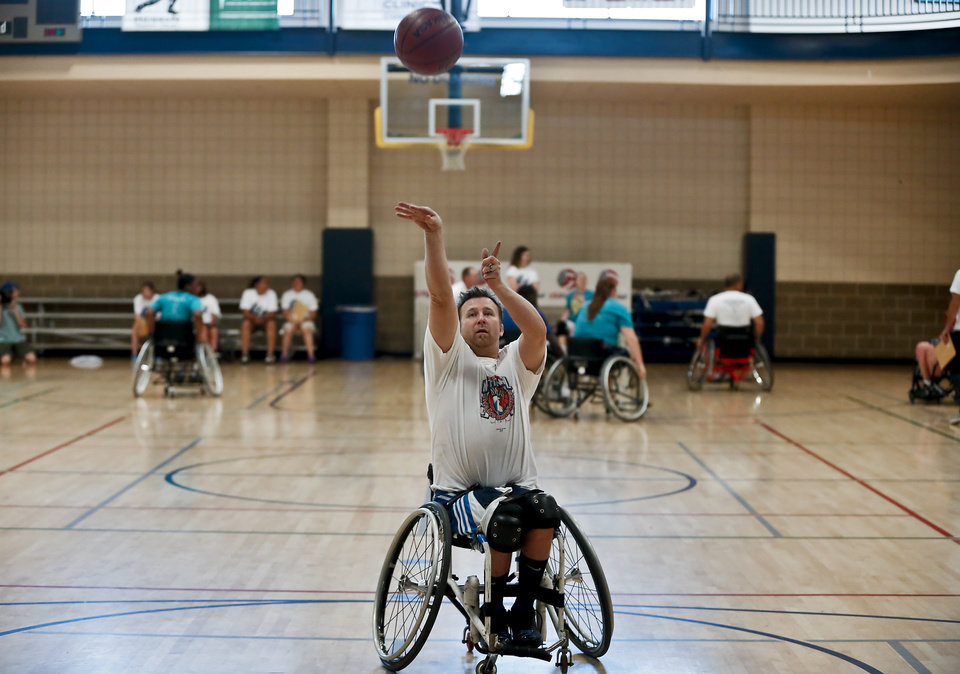 Tim Eldridge puts up a shot while warming up for the three on three basketball games during the Endeavor Games at the University of Central Oklahoma on Friday, June 7, 2013 in Edmond, Okla.  Photo by Chris Landsberger, The Oklahoman
