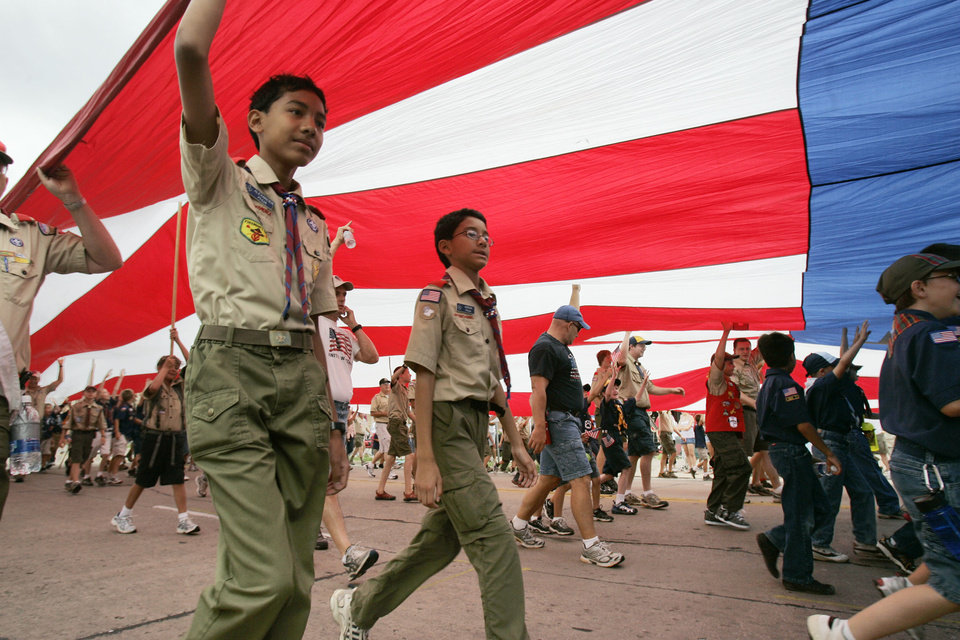 Boy Scout troops carry a huge flag in the LibertyFest Parade in downtown Edmond, OK, Saturday, July 4, 2009. By Paul Hellstern, The Oklahoman