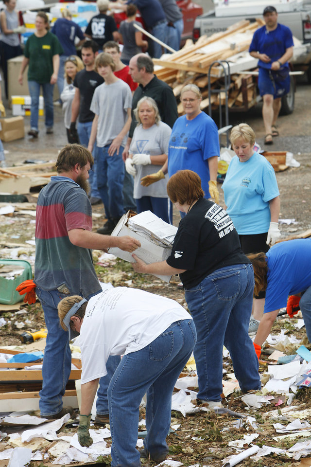 Students, teachers and administrators form a line to pass paperwork out of the debris of the Little Axe School Central Office, Tuesday, May 11, 2010. The school was hit by a tornado Monday, May 10, 2010. Photo by David McDaniel, The Oklahoman