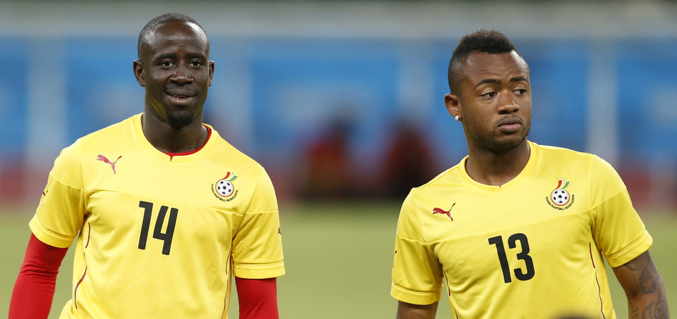 Photo - Ghana's Albert Adomah, left, and teammate Jordan Ayew warm up during an official training session the day before the group G World Cup soccer match between Germany and Ghana at the Arena Castelao in Fortaleza, Brazil, Friday, June 20, 2014. (AP Photo/Matthias Schrader)