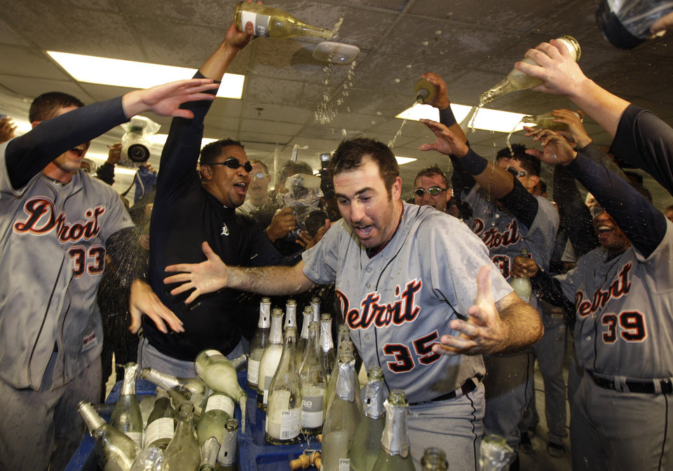Detroit Tigers\' Justin Verlander (35) is drenched with sparkling wine by teammates at the end of Game 5 of during the American League division baseball series in Oakland, Calif., Thursday, Oct. 11, 2012. (AP Photo/Ben Margot)