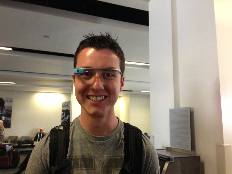 Photo - Brock Shetley, a University of Oklahoma sophomore, tries on Glass at the Los Angeles airport. PHOTO BY LILLIE-BETH BRINKMAN, THE OKLAHOMAN.