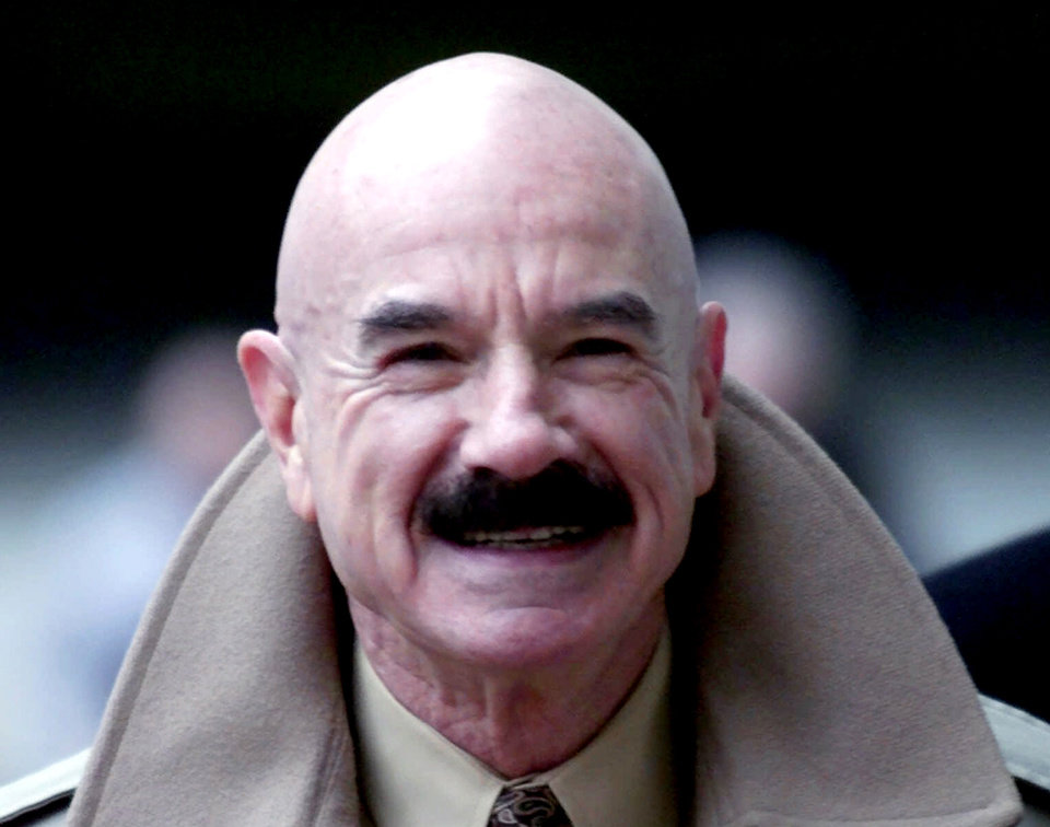 FILE This Jan. 16, 2001 file photo shows G. Gordon Liddy, a Watergate conspirator, arriving at Baltimore's federal courthouse. Some documents sealed in the 1970s as part of the court case against seven men involved in the Watergate burglary must be released, a federal judge in Washington says. The records, Luke Nichter, from Texas A&M University-Central Texas in Killeen, is seeking is in the case of U.S. v. Liddy that involved the five men arrested during the Watergate break-in as well as the two men who orchestrated the operation, G. Gordon Liddy and E. Howard Hunt. (AP Photo/Roberto Borea, File)