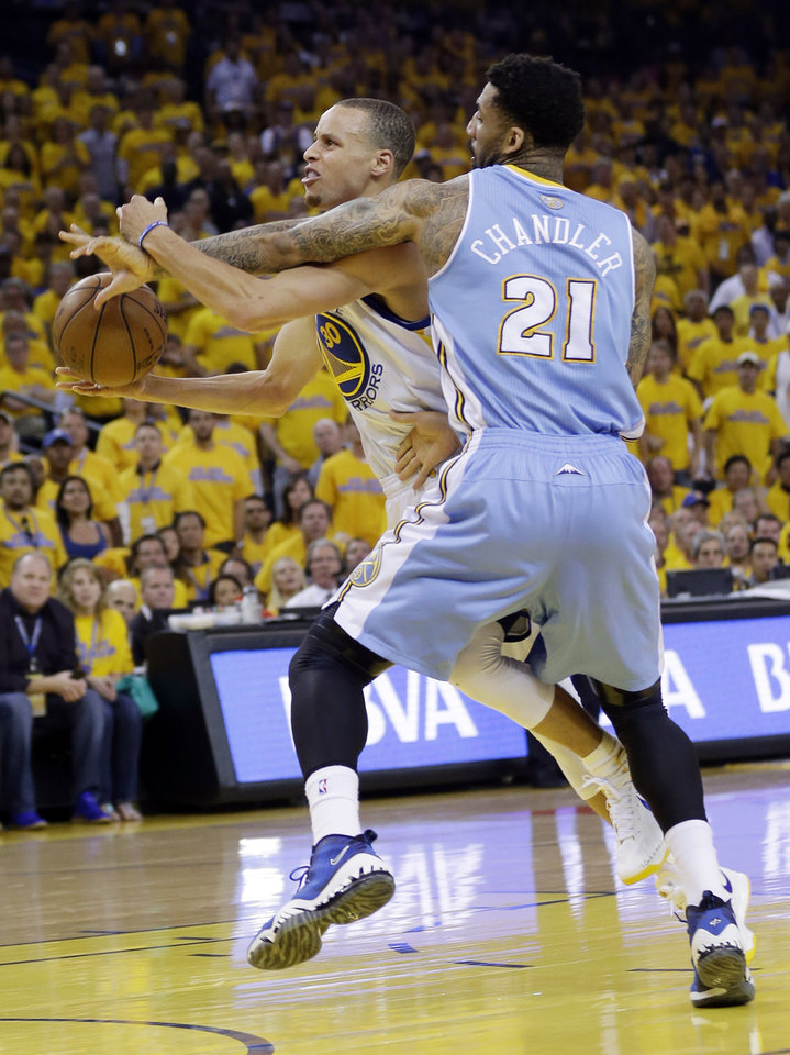 Golden State Warriors' Stephen Curry, left, is fouled going to the basket by Denver Nuggets' Wilson Chandler (21) during the first half of Game 6 in a first-round NBA basketball playoff series in Oakland, Calif., Thursday, May 2, 2013. (AP Photo/Marcio Jose Sanchez)