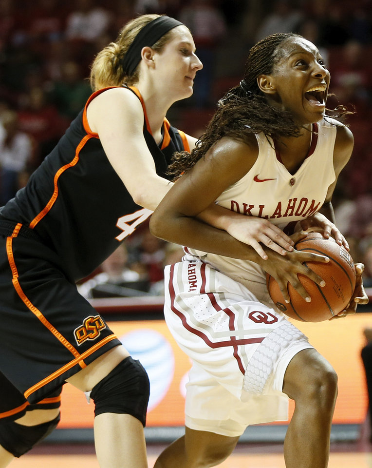 Oklahoma State's Liz Donohoe (4) fouls Oklahoma's Sharane Campbell (24) after Campbell stole the ball from Donohoe late in the second half during a women's Bedlam college basketball game between the Oklahoma State University Cowgirls (OSU) and the University of Oklahoma Sooners (OU) at Lloyd Noble Center in Norman, Okla., Saturday, Feb. 1, 2014. OU won, 81-74. Photo by Nate Billings, The Oklahoman
