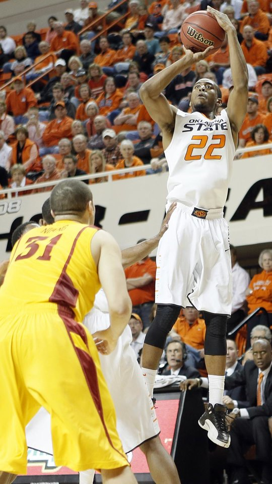 Oklahoma State Cowboys\' Markel Brown (22) shoots over Iowa State Cyclones\' Georges Niang (31) during the college basketball game between the Oklahoma State University Cowboys (OSU) and the Iowa State University Cyclones (ISU) at Gallagher-Iba Arena on Wednesday, Jan. 30, 2013, in Stillwater, Okla. Photo by Chris Landsberger, The Oklahoman