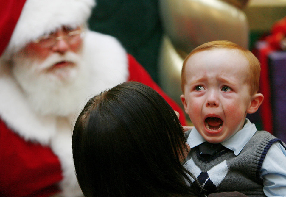 "FIRST PLACE, FEATURE PHOTO: Danny Nichols, 2 1/2, Oklahoma City, shows his tears at Penn Square Mall Friday afternoon, Dec. 12, 2008.  This Santa Claus has been playing the ""jolly man"" for more than 20 years, he said. His beard is real.  What he enjoys most about playing Santa is the ""smiles on the kids' faces.  You can't help but love it.""  He said, ""I'm tired when it's over, but I look forward to it every year.""   BY JIM BECKEL, THE OKLAHOMAN"
