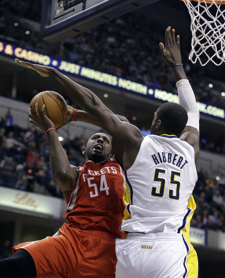 Houston Rockets' Patrick Patterson (54) puts up a shot against Indiana Pacers' Roy Hibbert during the first half of an NBA basketball game Friday, Jan. 18, 2013, in Indianapolis. (AP Photo/Darron Cummings)