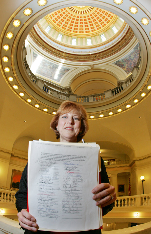 Photo - HB834: Anadarko music teacher Pamela Martin holds a list with signatures from Oklahoma educators concerned about HB 834 at the state Capitol in Oklahoma City, Oklahoma March 25, 2009.  BY STEVE GOOCH, THE  OKLAHOMAN.  ORG XMIT: KOD