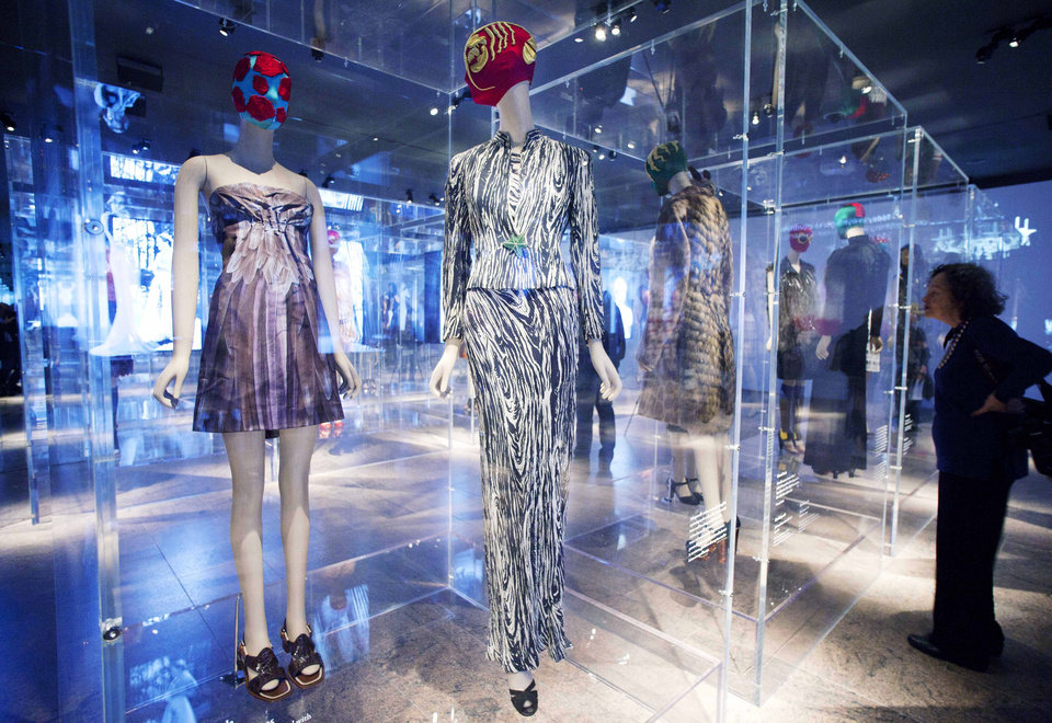 "A 2005 dress, left, by Miuccia Prada, and a 1938 ensemble, center, by Elsa Schiaparelli are displayed at the Metropolitan Museum of Art, Monday, May 7, 2012 in New York. The show ""Schiaparelli and Prada, Impossible Conversations,"" opens May 10 and continues through Aug. 19. (AP Photo/Mark Lennihan)"