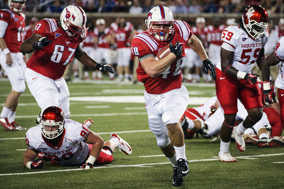 Photo -   SMU running back Zach Line (48) breaks away from the Houston defense on a 12-yard touchdown run during the first quarter of an NCAA college football game, Thursday, Oct. 18, 2012, in Dallas. (AP Photo/Houston Chronicle, Smiley N. Pool) MANDATORY CREDIT