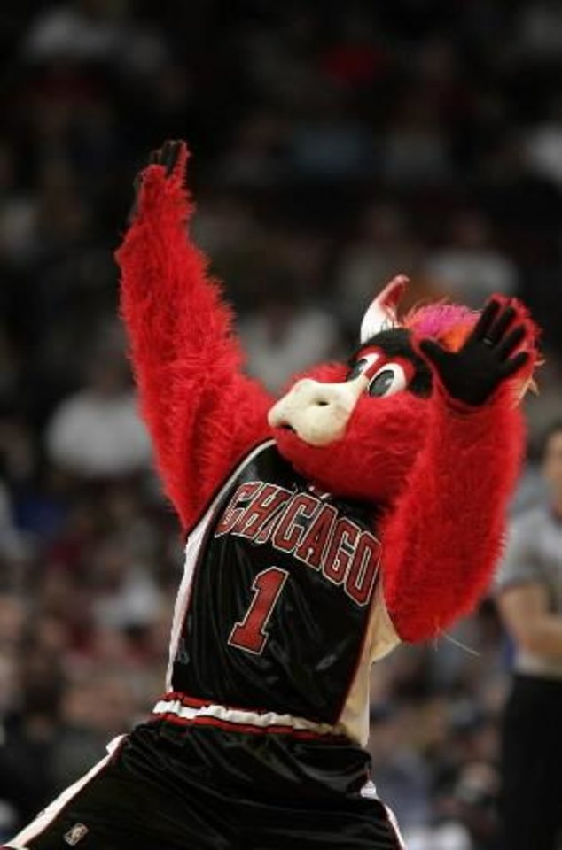 Photo - Chicago Bulls  mascot Benny the Bull dances during a time in this April 1, 2006 file photo in Chicago. (AP Photo/Jeff Roberson)