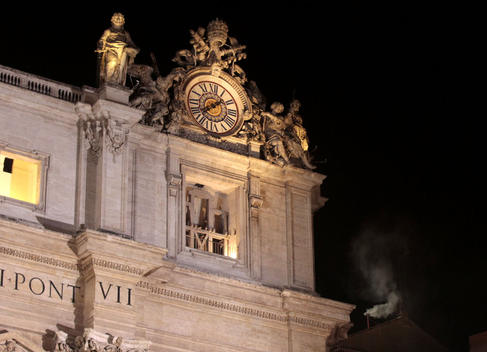 White smoke emerges from the chimney on the roof of the Sistine Chapel, right, in St. Peter's Square at the Vatican, Wednesday, March 13, 2013. The Catholic church has chosen a new pope. White smoke is billowing from the chimney of the Sistine Chapel, meaning 115 cardinals in a papal conclave have elected a new leader for the world's 1.2 billion Catholics.  (AP Photo/Gregorio Borgia) ORG XMIT: VAT126