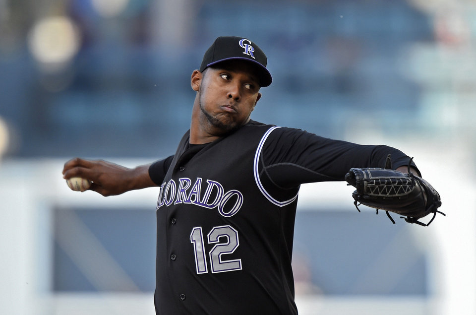 Photo - Colorado Rockies starting pitcher Juan Nicasio throws to the plate during the second inning of a baseball game against the Los Angeles Dodgers, Saturday, April 26, 2014, in Los Angeles. (AP Photo/Mark J. Terrill)