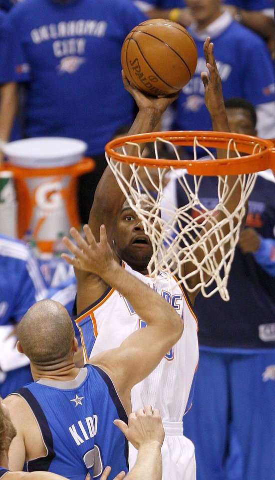 Photo - Oklahoma City's Kevin Durant (35) shoots the ball over Jason Kidd (2) of Dallas during game 4 of the Western Conference Finals in the NBA basketball playoffs between the Dallas Mavericks and the Oklahoma City Thunder at the Oklahoma City Arena in downtown Oklahoma City, Monday, May 23, 2011. Photo by Bryan Terry, The Oklahoman