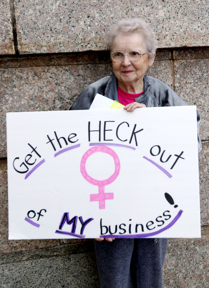 Photo - Wanda Jo Stapleton of Oklahoma City holds a sign during a rally opposing the Personhood measures at the state Capitol, Tuesday, Feb. 28, 2012. Photo by Sarah Phipps, The Oklahoman