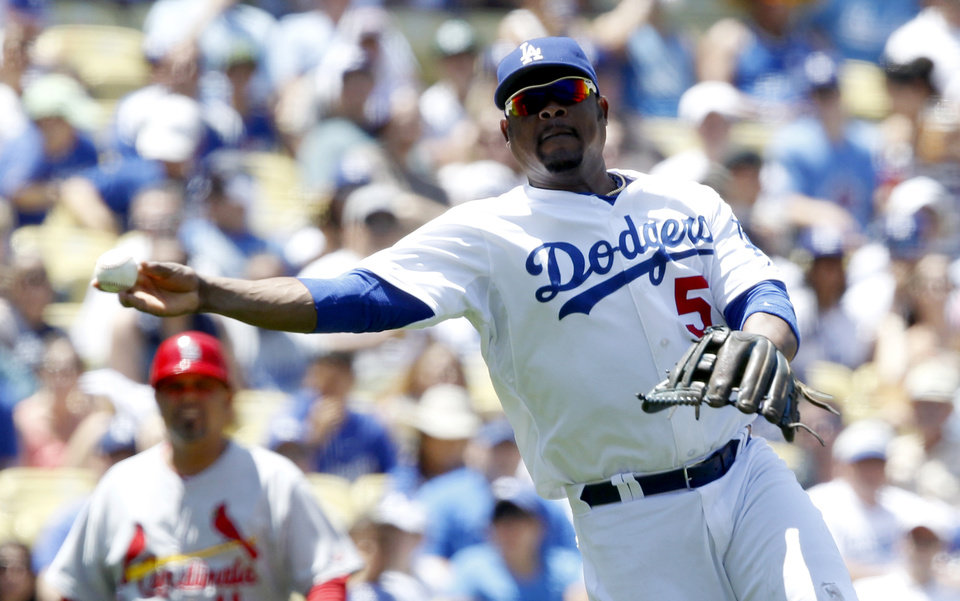Photo - Los Angeles Dodgers third baseman Juan Uribe throws out St. Louis Cardinals' Yadier Molina on a ground ball in the fourth inning of a baseball game on Sunday, June 29, 2014, in Los Angeles. (AP Photo/Alex Gallardo)