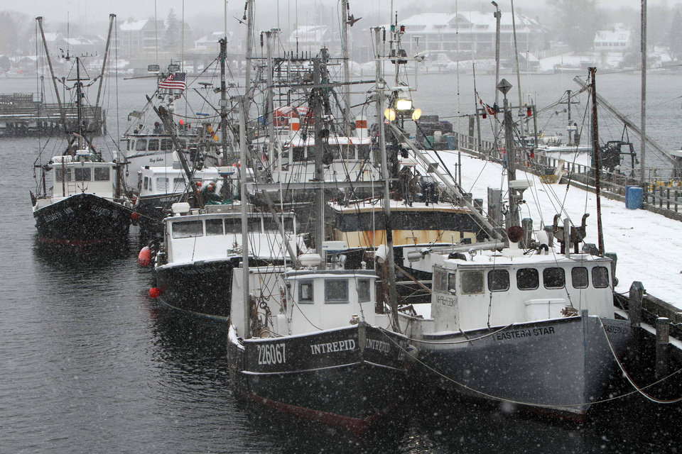 Snow falls on fishing boats at the state fishing pier in Portsmouth, N.H., Friday, Feb. 8, 2013. Fisherman are staying off the water in the Northeast as a major snowstorm moves in. (AP Photo/Jim Cole)