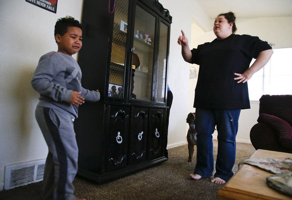 Photo -  Isaiah Roberson, 6, cries as his mom, Desha Bailey, grounds him from video games. Bailey regained custody of her two sons after battling and recovering from a drug addiction. [Photo by Jessie Wardarski, Tulsa World]