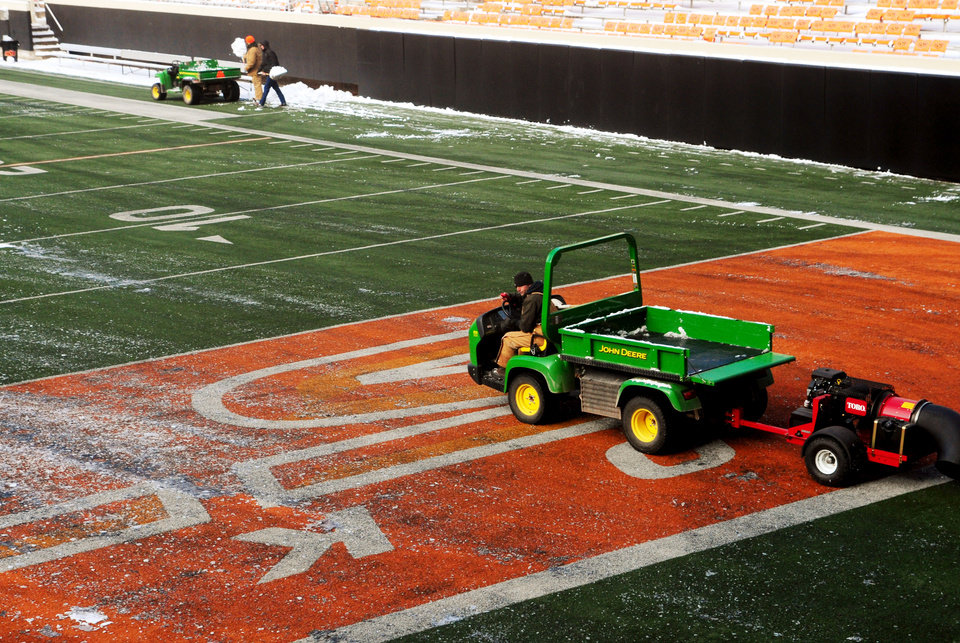Stillwater and the campus of Oklahoma State received heavy snowfall on Thursday and Friday ahead of Saturday's bedlam football game. The Oklahoma State athletic department was forced to clear the snow quickly, using small tractors to clear the field on Dec. 6, 2013. KT King/For the Tulsa World