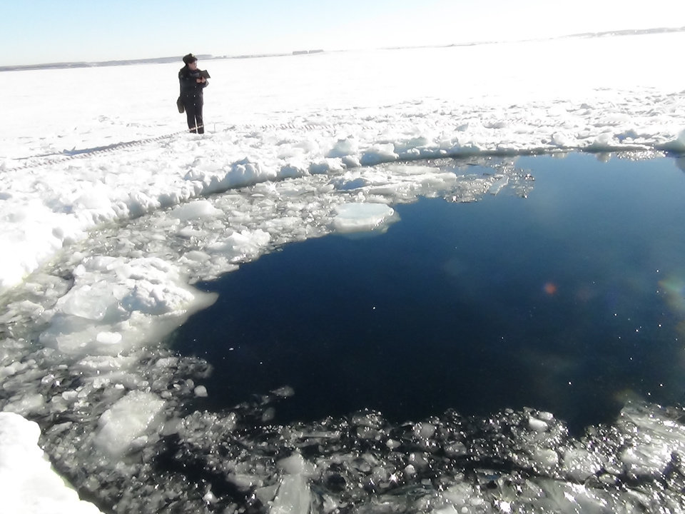 Photo - A circular hole in the ice of Chebarkul Lake where a meteor reportedly struck the lake near Chelyabinsk, about 1500 kilometers (930 miles) east of Moscow,  Russia,  Friday, Feb. 15, 2013. A  meteor streaked across the sky and exploded over Russia's Ural Mountains with the power of an atomic bomb Friday, its sonic blasts shattering countless windows and injuring nearly 1,000 people. (AP Photo)