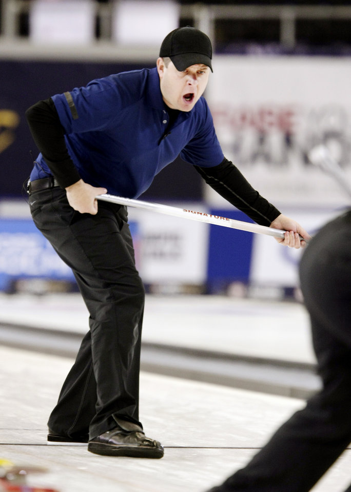 John Shuster shouts out to the Team Shuster members as they play against Team Fenson at the U.S. Olympic curling trials Saturday, Nov. 16, 2013, in Fargo, N.D. (AP Photo/The Forum, Dave Wallis)