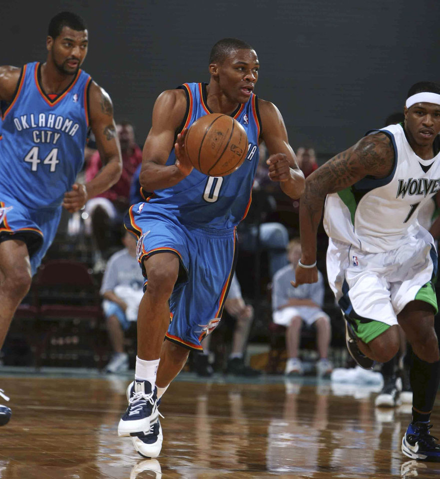 Photo - OKLAHOMA CITY THUNDER NBA BASKETBALL TEAM:  ** ADDS NAMES OF MINNESOTA PLAYER ** Oklahoma City's Russell Westbrook heads upcourt during a preseason NBA basketball game against the Minnesota Timberwolves on Wednesday, Oct. 8, 2008, in Billings, Mont. At right is Minnesota's Rashad McCants. (AP Photo/Billings Gazette, Paul Ruhter) ORG XMIT: MTBIL104