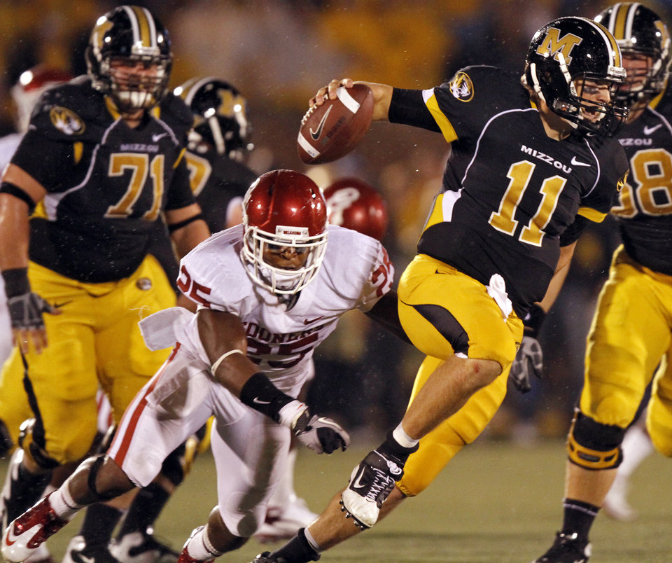Photo - Missouri quarterback Blaine Gabbert (11) gets away from Oklahoma's Emmanuel Jones (25) during the second half of the college football game between the University of Oklahoma Sooners (OU) and the University of Missouri Tigers (MU) on Saturday, Oct. 23, 2010, in Columbia, Mo. Oklahoma lost the game 36-27. Photo by Chris Landsberger, The Oklahoman