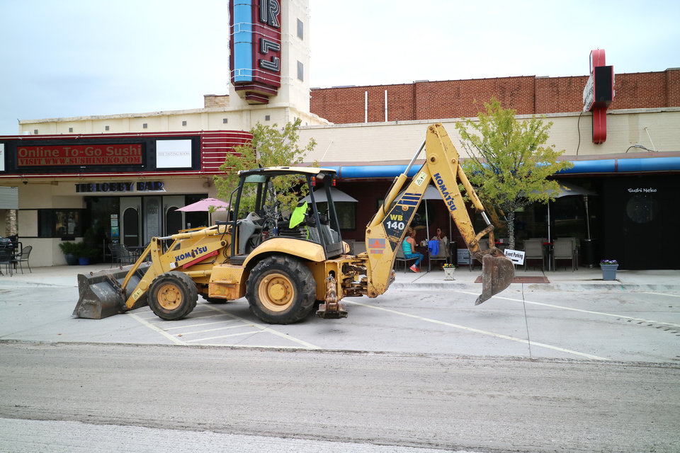 Photo -  A piece of construction equipment is parked outside the Will Rogers Theatre at 4322 N Western on Tuesday, October 26, 2016. [Photo by Doug Hoke, The Oklahoman]