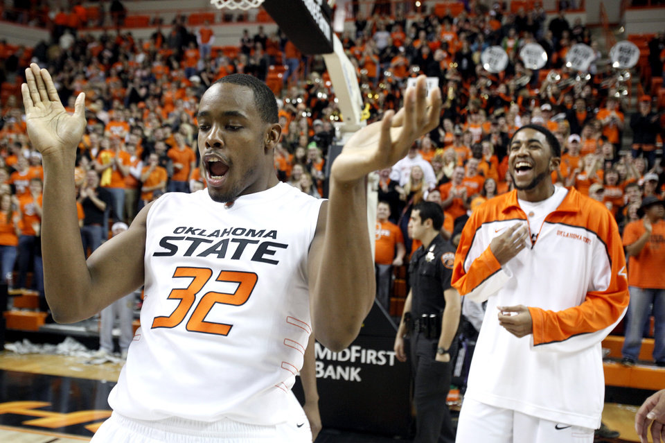 Photo - Oklahoma State's Roger Franklin (32) celebrates as Cowboy win as Mike Cobbins looks on during the Bedlam men's college basketball game between the University of Oklahoma Sooners and Oklahoma State University Cowboys at Gallagher-Iba Arena in Stillwater, Okla., Saturday, February, 5, 2011. Photo by Sarah Phipps, The Oklahoman