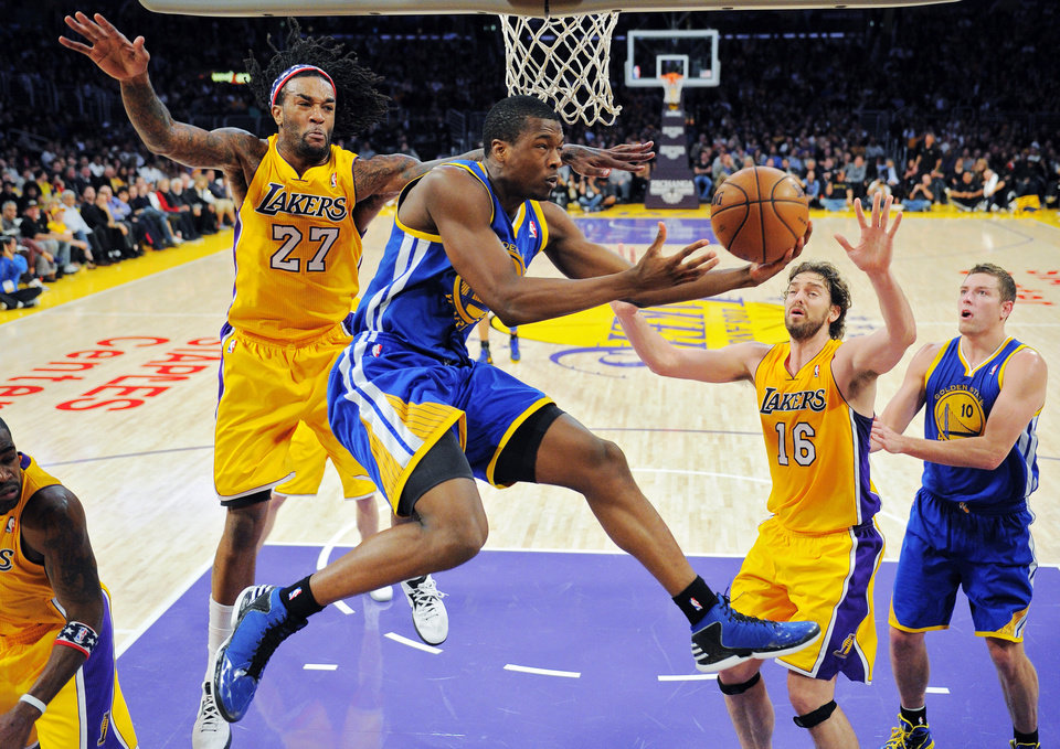 Photo -   Golden State Warriors forward Harrison Barnes, second from left, goes up for a shot as Los Angeles Lakers center Jordan Hill, left, and forward Pau Gasol, second from right, of Spain, defend and Warriors forward David Lee watches during the first half of their NBA basketball game, Friday, Nov. 9, 2012, in Los Angeles. (AP Photo/Mark J. Terrill)