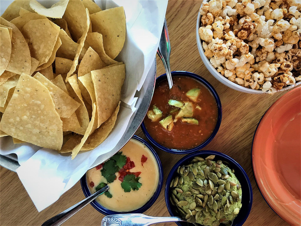 Photo -  Chips, salsa, guacamole and queso, plus seasoned popcorn, at Revolucion in downtown Oklahoma City. [Photo by Dave Cathey, The Oklahoman]