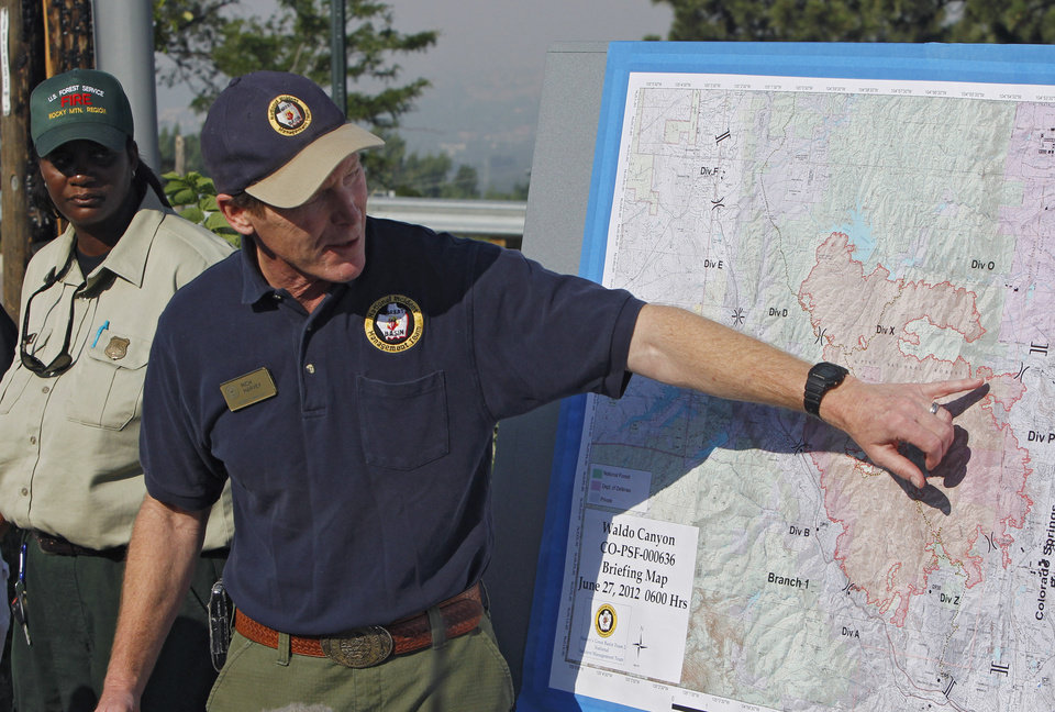 Photo -   Incident Commander Rich Harvey uses a map as he talks about the Waldo Canyon wildfire during a briefing in Colorado Springs, Colo., on Wednesday, June 27, 2012. Authorities say it remains too dangerous for them to fully assess the damage from a destructive wildfire threatening Colorado's second-largest city. (AP Photo/Ed Andrieski)