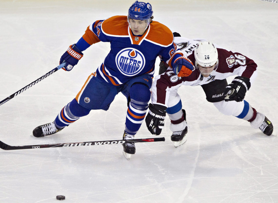 Edmonton Oilers\' Nail Yakupov, left, battles for the puck with Colorado Avalanche\'s Paul Stastnyduring the second period of their NHL hockey game, Monday, Jan. 28, 2013, in Edmonton, Alberta. (AP Photo/The Canadian Press, Jason Franson)