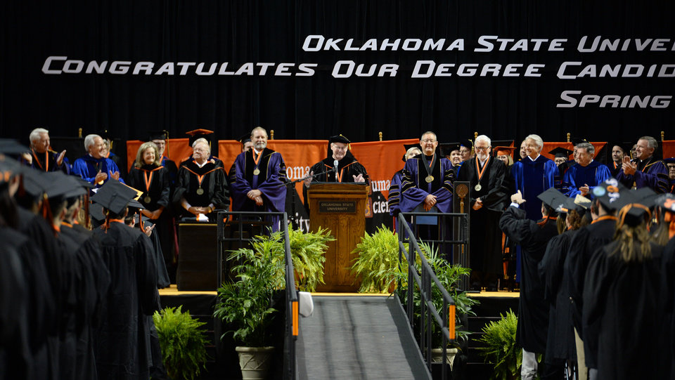 Photo - Burns Hargis addresses the Oklahoma State University Graduates during the Spring 2016 commencement ceremony in Gallagher-Iba Arena in Stillwater, Oklahoma on Saturday May 7, 2016. Jackie Dobson for the Oklahoman