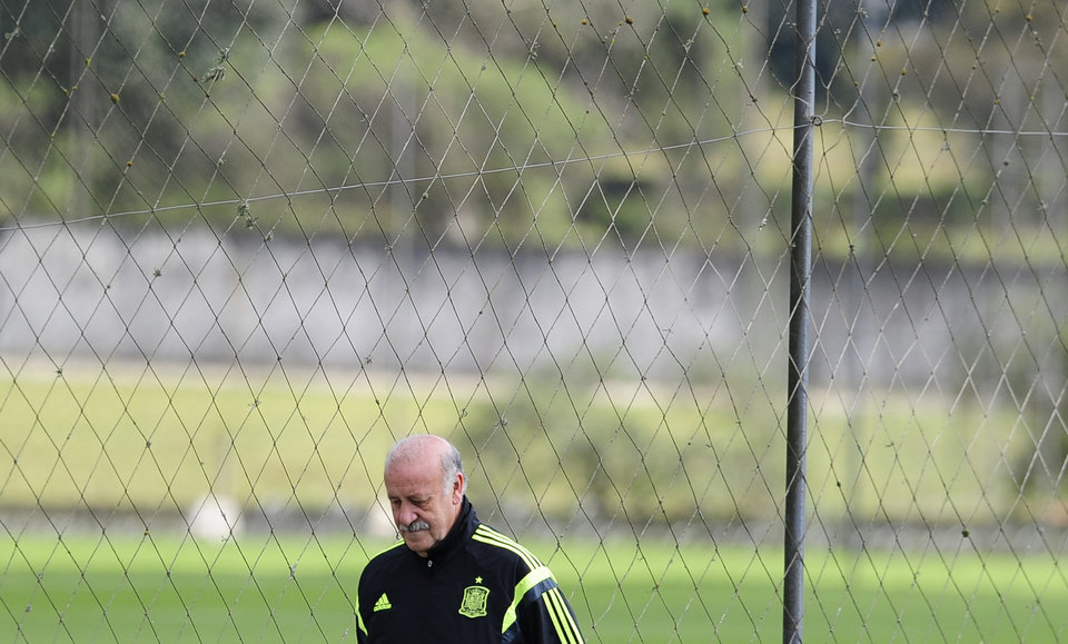 Photo - Spain's head coach Vicente del Bosque looks down during an official training session the day before the group B World Cup soccer match between Spain and Australia at the Atletico Paranaense training center in Curitiba, Brazil, Sunday, June 22, 2014. Spain will play in group B of the Brazil 2014 World Cup. (AP Photo/Manu Fernandez)